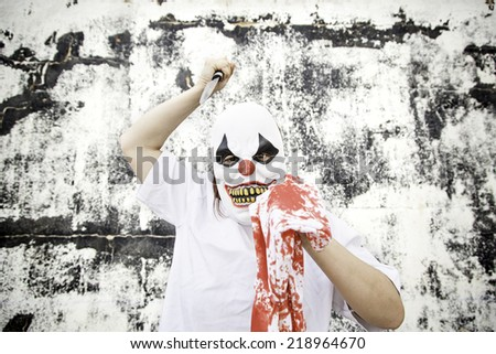 Crazy clown mask halloween costume and fear - stock photo