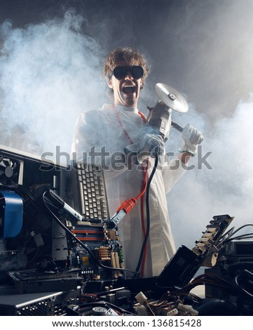 Crazy computer technician is trying to repair a computer - stock photo