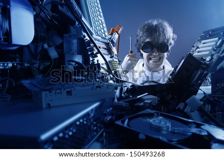 Crazy computer technician is trying to repair a computer