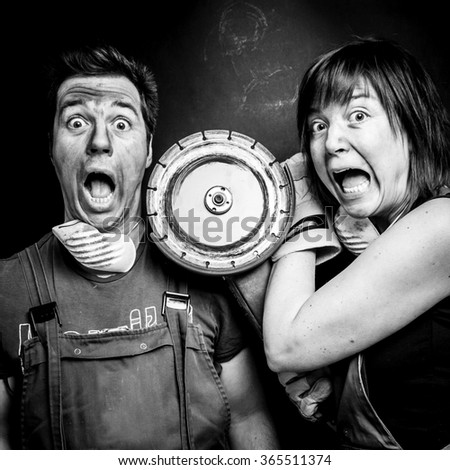 Crazy couple having an argument with some construction tools; - stock photo