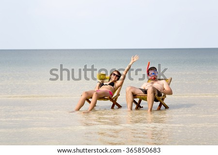 Crazy couple sunbathing, fantastic crystal water, koh rong island, cambodia