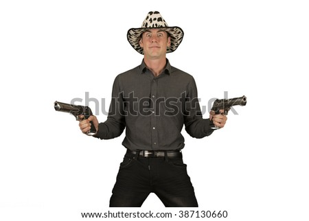 Crazy cowboy holding two guns - stock photo