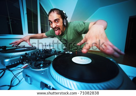 Crazy DJ Scratching on the Turntables at house party