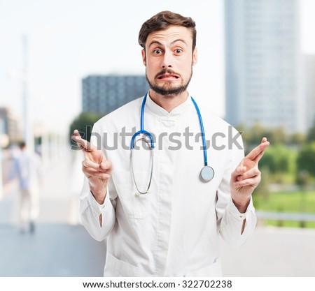 crazy doctor man cross fingers - stock photo