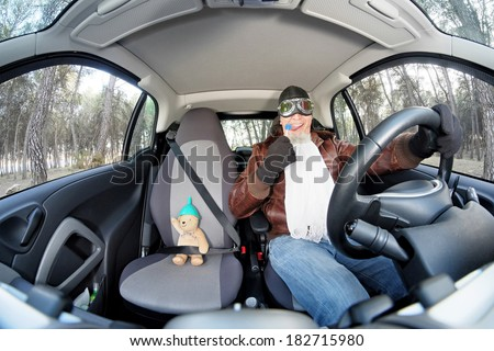 Crazy driver with little bear into a car. - stock photo