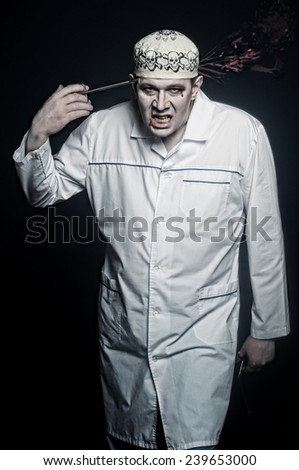 crazy evil doctor Dentist in a white coat.isolated studio portrait - stock photo