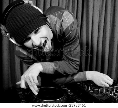 Crazy funky DJ playing in a nightclub - stock photo