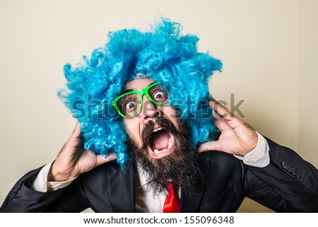 crazy funny bearded man with blue wig on white background