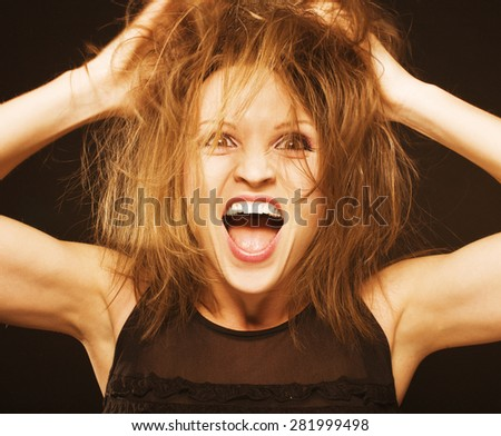 crazy funny goofy girl with messed hair close up screaming