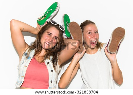 Crazy girls holding shoes