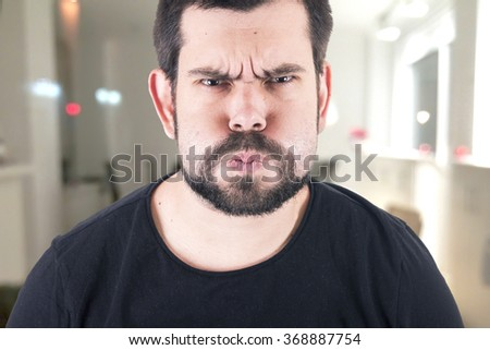 Crazy guy blowing - stock photo