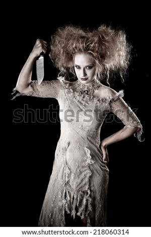 Crazy hair beautiful Witch holding a Knife