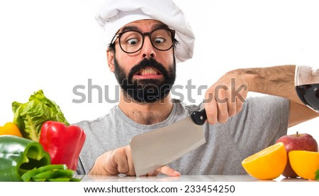 Crazy hipster chef cutting his finger - stock photo