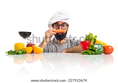 Crazy hipster chef with carrot like moustache - stock photo