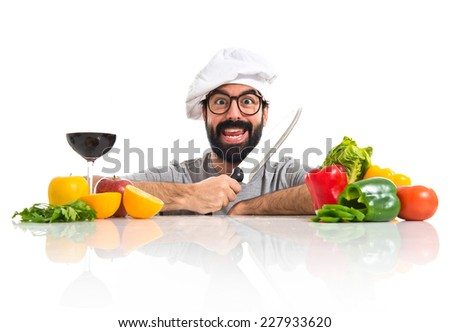 Crazy hipster chef with several vegetables and fruits - stock photo