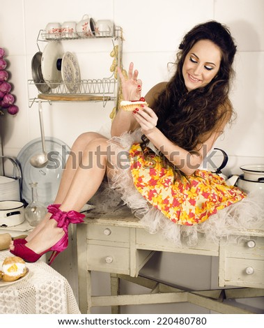 crazy housewife on kitchen smiling eating - stock photo