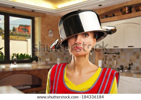 Crazy housewife with sause pan - stock photo