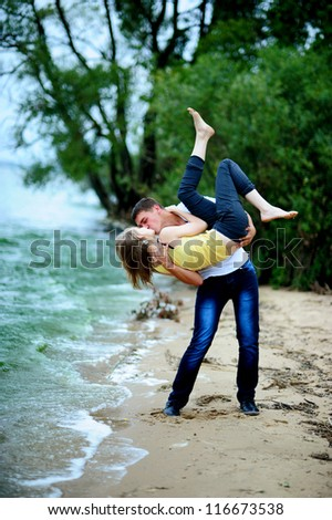 crazy  love couple embracing and kissing outdoor looking happy - stock photo