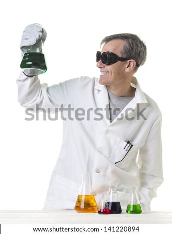 Crazy mad scientist with discovery - stock photo