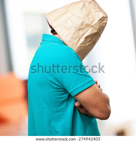 crazy man with paper bag in his head. angry or sad concept