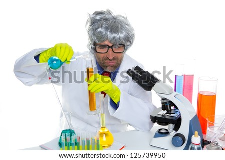Crazy nerd scientist silly man gray hair on chemical laboratory - stock photo