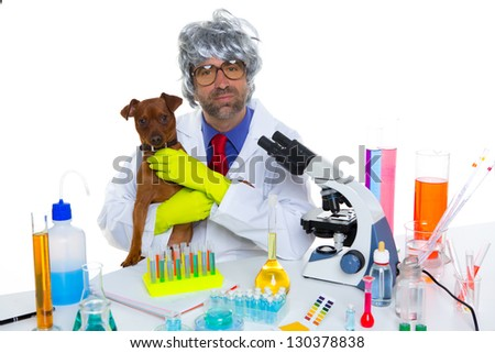 Crazy nerd scientist silly veterinary man with dog in chemical laboratory - stock photo