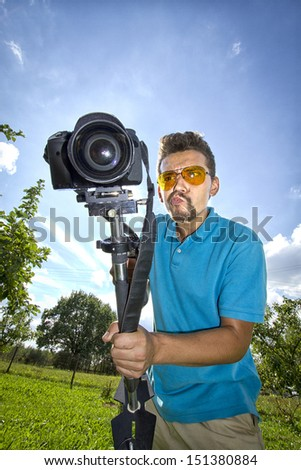 crazy operator with a flag and a camera - stock photo