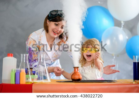 Crazy professor conducting chemical experiments in the company of a little girl.