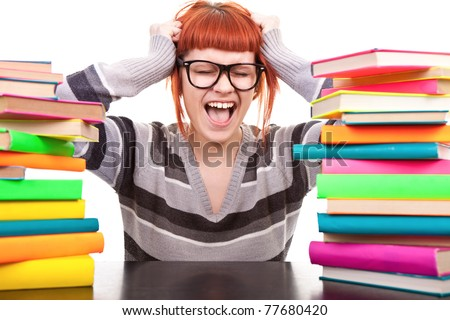 crazy schoolgirl screaming, holding hands up, between, stack of book, isolated on white - stock photo