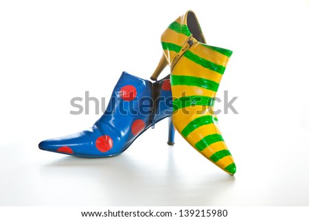 Crazy shoes, with polka dots and stripes, for self expression on white - stock photo