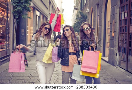 crazy shopping in the center of milan. concept about consumerism and shopping - stock photo