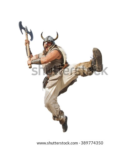 crazy strong viking with traditional costume attacking. studio shot, isolated on white background. looking at camera with angry eyes.