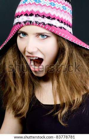 Crazy teenage girl with braces