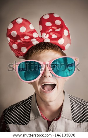 crazy teenager in big glasses  - stock photo