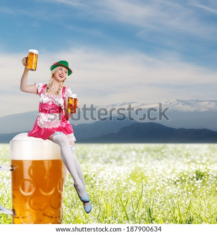 crazy tiroler or oktoberfest woman with a big glass of beer in her hands is sitting on a beer and on the background mountains  - stock photo