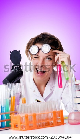 Crazy woman chemist in lab - stock photo