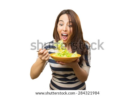Crazy woman eating salad. Over white background - stock photo