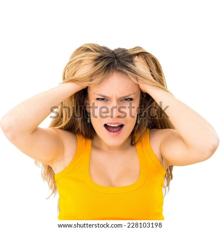 crazy woman making a face and pulling hair on white background