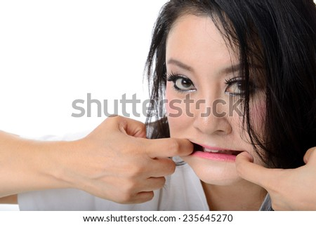 crazy woman pull her mouth with both hand - stock photo