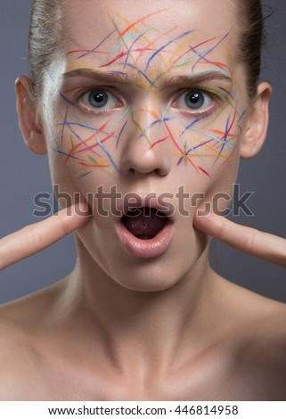 crazy woman with perfect skin and colored lines