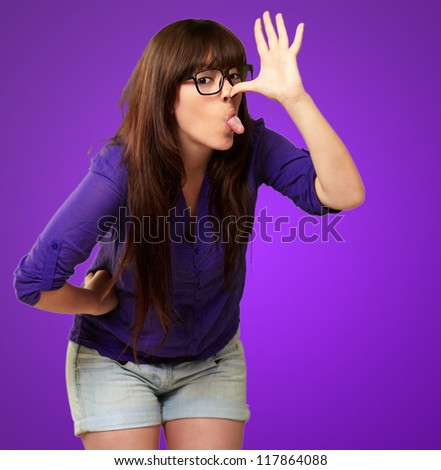 Crazy Woman With Stick Out Tongue Isolated On Purple Background - stock photo
