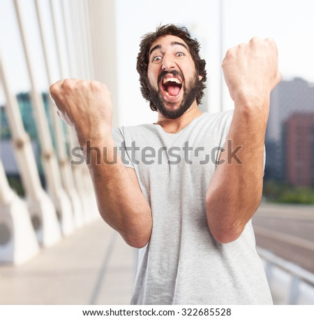 crazy young man celebrating pose - stock photo