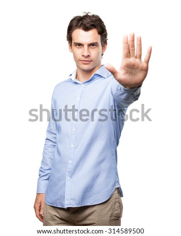 crazy young man stop gesture - stock photo