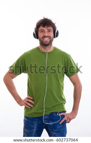 Crazy young man with headphones listening music. Joke poses