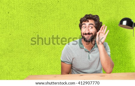crazy young man with table .happy expression - stock photo