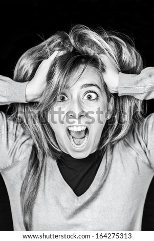 Crazy young woman screaming, detail of an attractive young and sexy screaming, expression and feelings