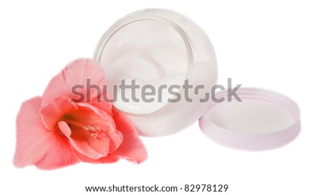 Cream and flower isolated on white background