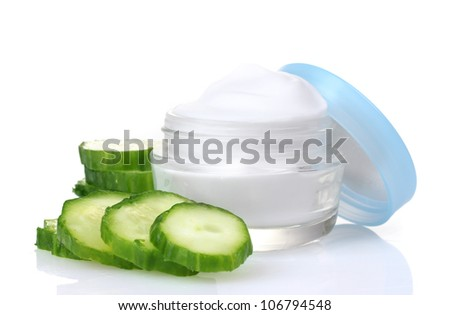 cream and fresh sliced cucumber isolated on white