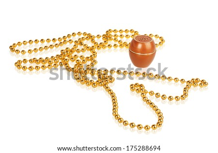cream and gold beads isolated on white background - stock photo
