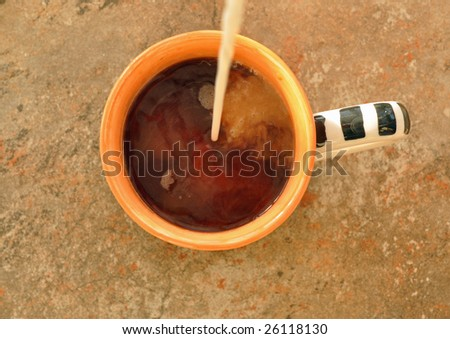 cream being poured into a cup of fresh coffee - stock photo